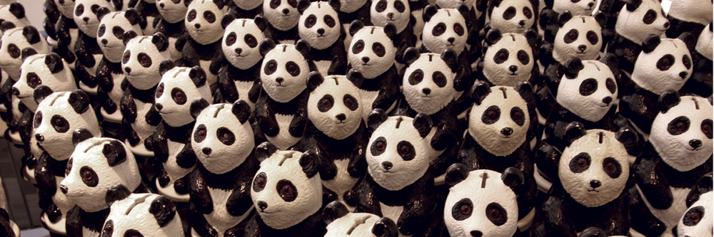 Panda Eyes: 100 WWF panda collection boxes rotating automatically to make eye contact with spectators.  Jason Bruges Studio, UK.