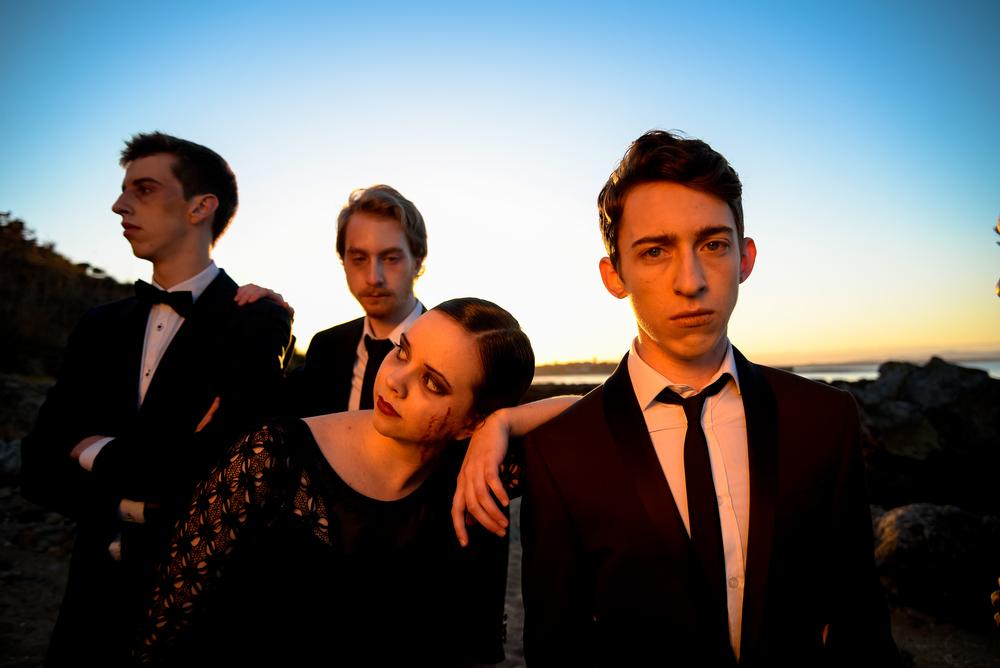 Laertes (AJ Brennan), Polonius (David Trimble), Ophelia (Kate Kitchens), and Hamlet (Jack Briggs)