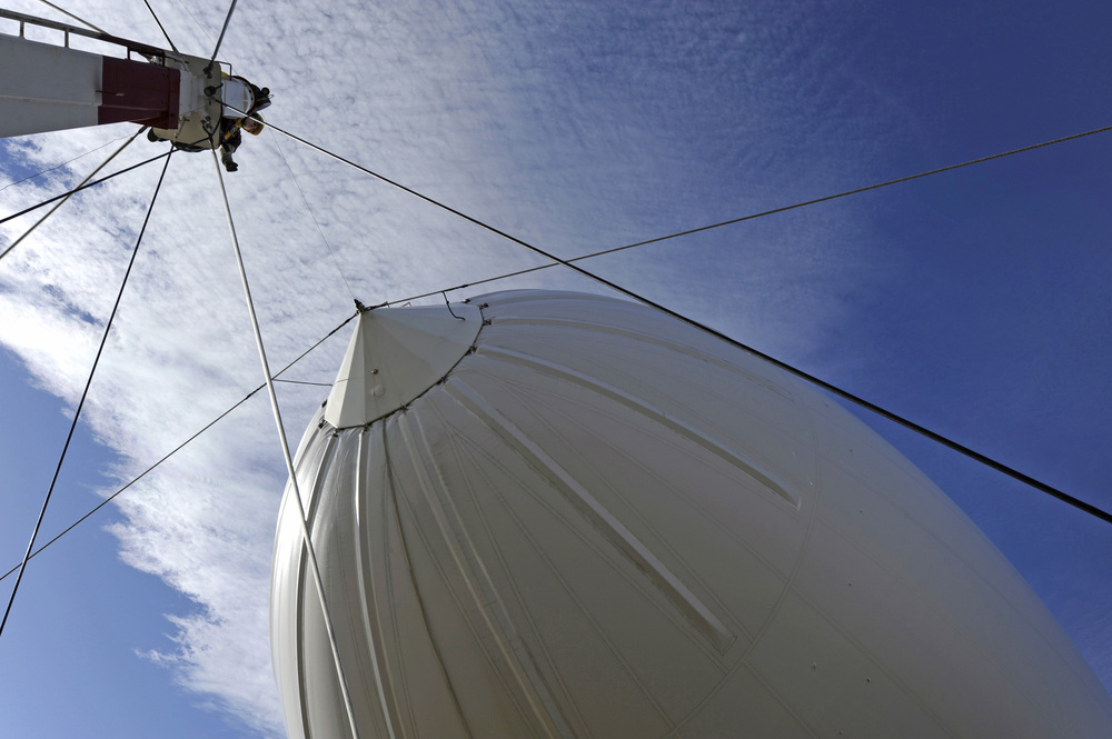 PATUXENT RIVER, Md.  - Karl Carkhuff, a civilian contractor with Integrated Systems Solutions, Inc., assists with mooring the Navy's MZ-3A manned airship following operations conducted at Patuxent River, Md. The MZ-3A, assigned to the Naval Research Laboratory Military Support Division's Scientific Development Squadron One (VXS-1), is an advanced flying laboratory used to evaluate affordable sensor payloads and provide support for other related science and technology projects for the Naval Research Enterprise.