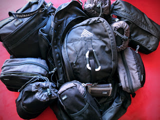 The Kelty Redwing backpack with Think Tank change up bag and various Think Tank pouches to keep gear protected during travel.