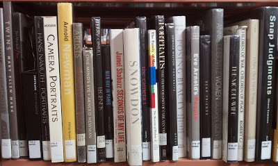 Photography books in the stacks at the Arlington County public library.