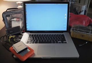 "Apple 15"" powerbook with LaCie Rugged 1TB drive and SanDisk FW 800 CF card reader."