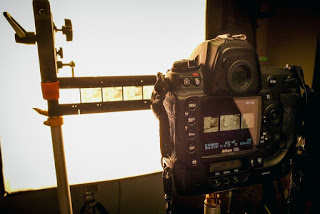 A DSLR set to copy negatives in front of a light source.
