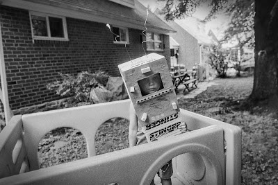 Backyard Astronaut in1994 taken with a Nikon N90 shot on Ilford HP5 Plus. I barely remember taking this photograph, but it has become one of my favorites.
