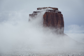 The fog clears to reveal Merrick Butte in Monument Valley, Ariz.