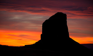 The overcast sky breaks just enough during this sunset in Monument Valley, Arizona.