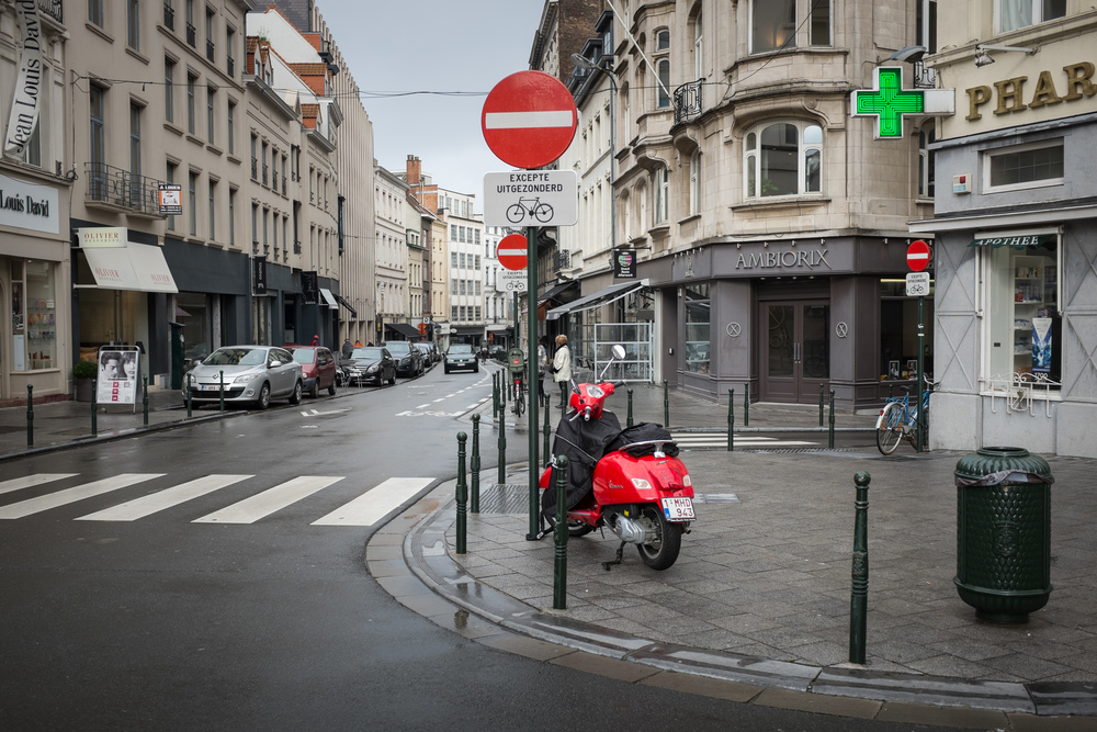 Red scooter and sign in Brussels, Belgium.