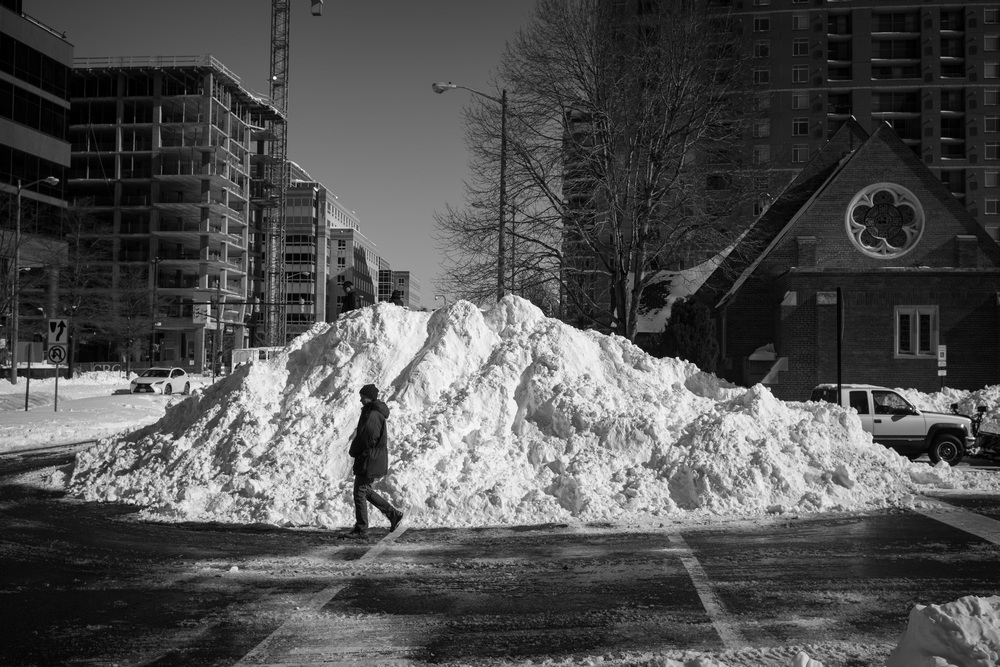 Placing a person in this photograph helps to show both scale and the dilemma of the pedestrian in the aftermath of the 2016 blizzard.