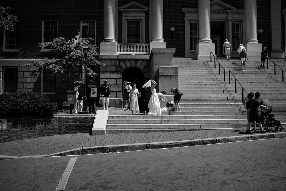 Annapolis wedding party on the Maryland State Capitol steps shot at 1/2500, f5.6 at ISO 400, -1.33 EV.