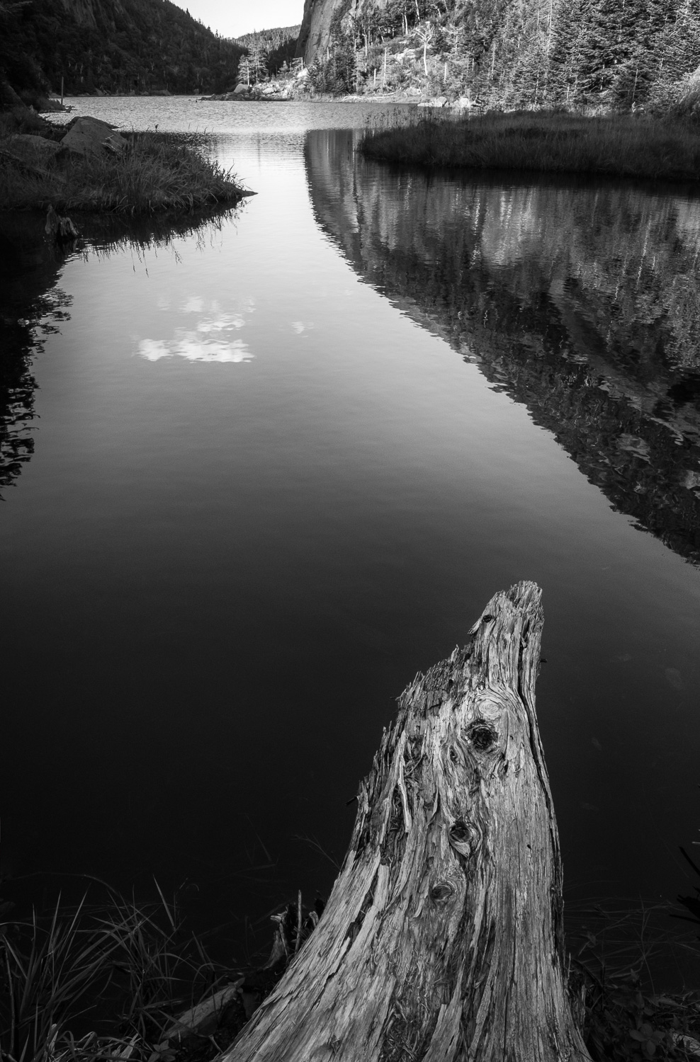 At this end of the lake, there is plenty of debris, mostly logs, that has built up and makes for some interesting foregrounds. In this case, I switched to a vertical and used this large branch to lead you into the photograph. Converting to monochrome emphasizes the contrast between the warm wood and the cool lake.  Fujifilm X-Pro2 with a 16mm lens, 1/60 @ f16, ISO 800, Exp. Comp. -0.3.