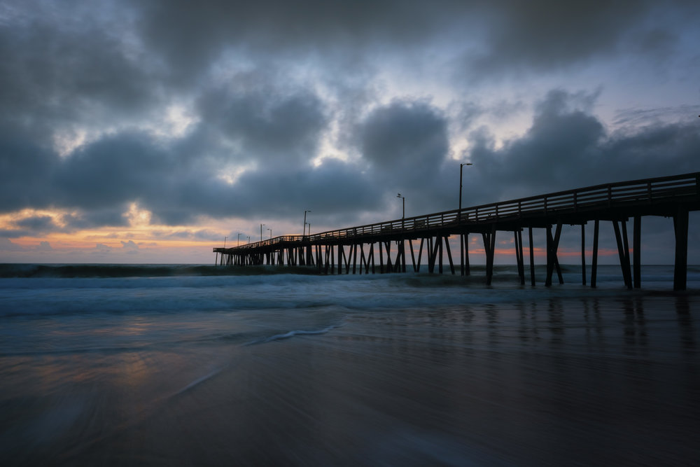 With sunrise or sunset photos, I like to have a foreground element. In this case, I used the pier which helps lead you into the photograph. The sun provides some backlight at the end of the pier and adds a subtle warmth overall without overpowering the photograph. Finally, I used a slow shutter speed to smooth out the surf, which further draws you in.  Fujifilm X-Pro2 with 16mm, 1 second @ f16, ISO 200.