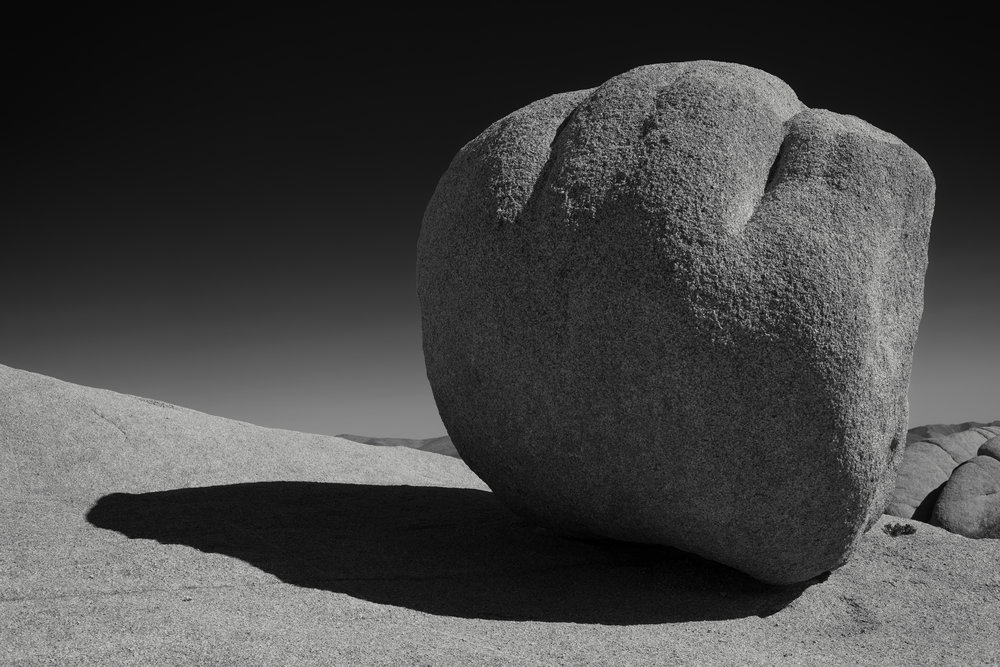 During the middle of the day I had a great time exploring a section of the national park called Jumbo Rocks. Lots of fun climbing around the granite rock formations in search of interesting shapes. I thought the light wrapping around this particular boulder which was balancing on an even bigger boulder made a nice composition. Choosing to convert to monochrome during post  processing helps to focus on that composition as does using a red filter, which turns the blue sky almost black.  Fujifilm X-Pro2 with a Fujinon XF 35mm f2 R WR, 1/900 @ f8.0, ISO 200 .