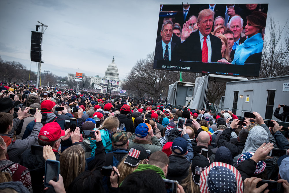 When I went to the 2009 inauguration of Barack Obama I was about a block farther away, so I knew that I would never get a photograph of the actual swearing in. So I positioned myself close to a screen in order to capture the moment.  Fujifilm X-Pro2 with a Fujinon XF 23mm f2 R WR, 1/320 @ f5.6, ISO 200.