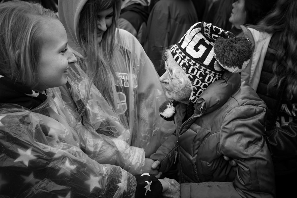 The 23mm allowed me to capture this moment between two first time inauguration attendees while moving in the crowds.  Fujifilm X-Pro2 with a Fujinon XF 23mm f2 R WR, 1/300 @ f2.8, ISO 200.