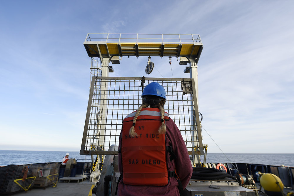 PACIFIC OCEAN - Sara Goheen, an engineer with Scripps Institution of Oceanography, operates a crane aboard the Auxiliary General Oceanographic Research (AGOR) vessel R/V Sally Ride during the retrieval of scientific equipment as part of a science verification cruise. Operated by Scripps under a charter lease agreement with the Office of Naval Research, Sally Ride has multi-beam bottom-mapping and ocean current profiling sonars, advanced meteorological sensors and satellite data transmission systems, the latest navigation and ship-positioning systems and a specially designed hull that improves sonar acoustic performance.