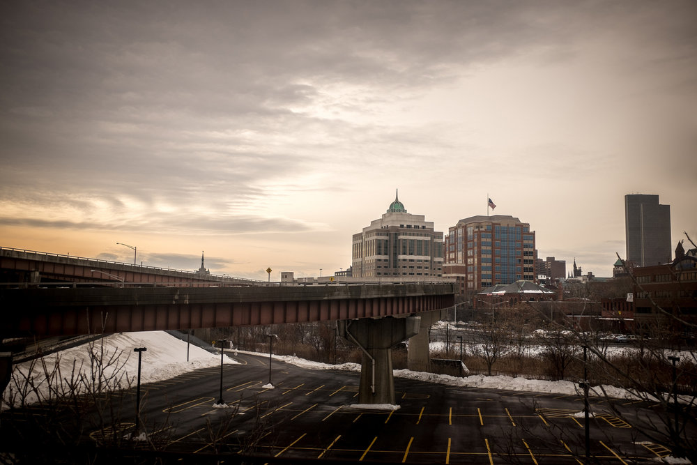 Downtown Albany, New York, as the sun goes down. I like the empty parking lot and elevated shooting position. A view that would be difficult if not for riding on the train. Fujifilm X100S, 1/1250 @ f2.8, ISO 400.