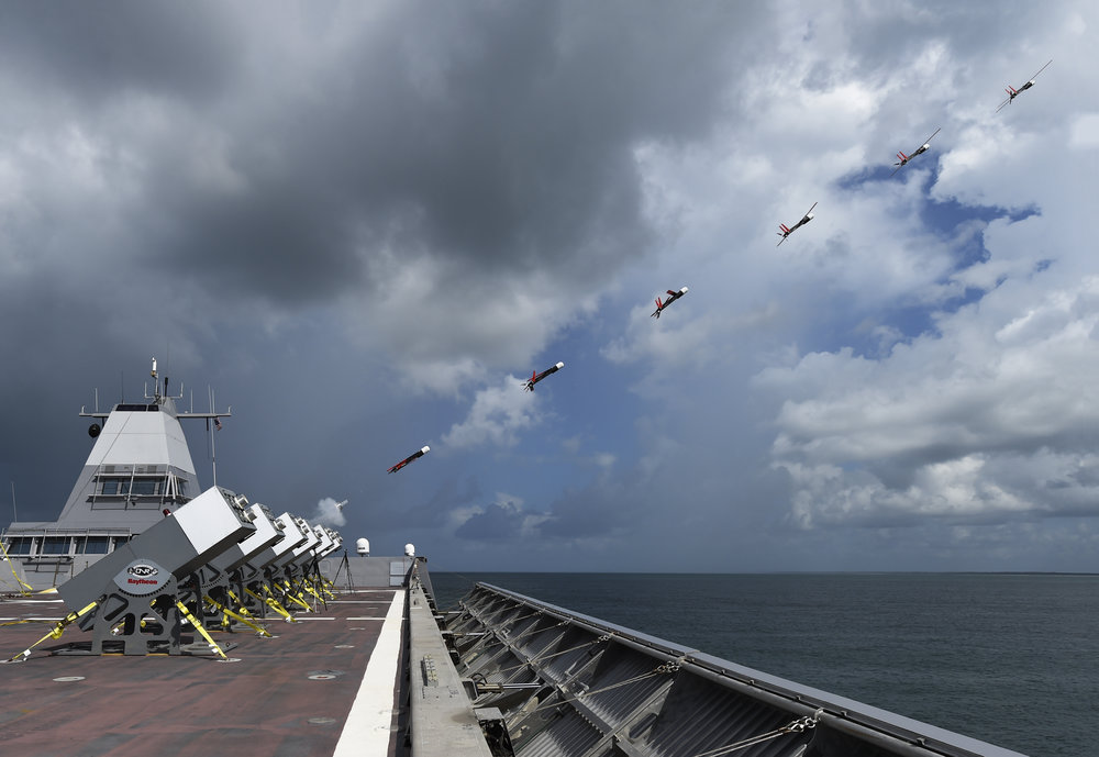 GULF OF MEXICO - A composite photograph shows Coyote unmanned air vehicles (UASs) being launched in rapid succession from the deck of Sea Fighter (FSF 1) during an at-sea demonstration of the Office of Naval Research Low0cost UAV Swarming Technology (LOCUST) program. LOCUST can launch swarming UAVs to autonomously overwhelm an adversary.