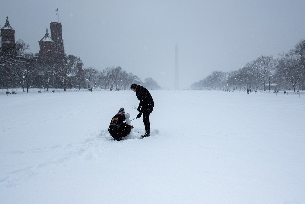 As the snow began to pick up in strength, I headed to the National Mall and found these two building a snowman. I like the simplicity of this shot, almost as if they are alone in America's backyard. Fujifilm X-Pro2, 18mm, 1/2500 @ f5.6, ISO 100.