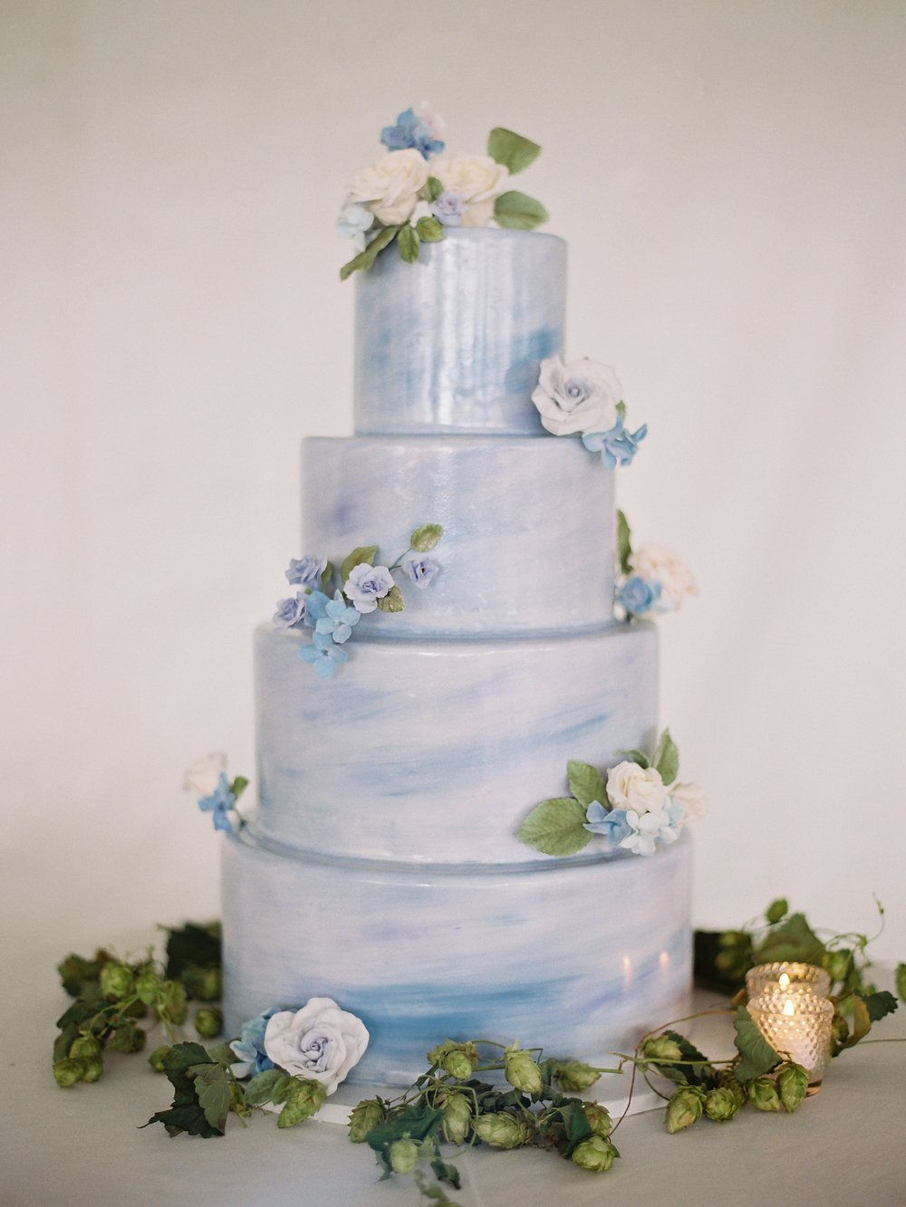 Painted cake with sugar flowers