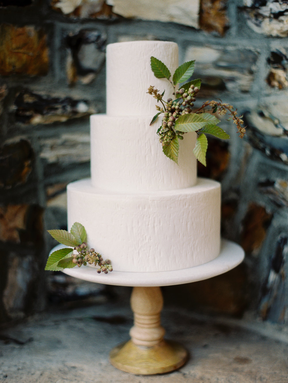 White textured cake with greenery