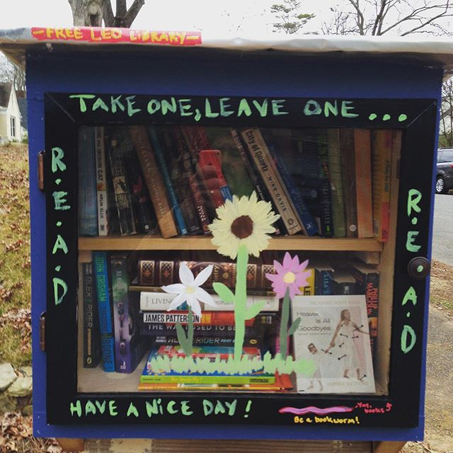 A Little wood some paint and some quickrete = instant community. #smallthingsmatter #readingisfundamental #howdyneighbor
