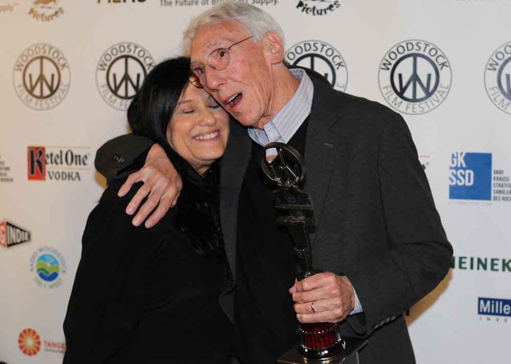 Esteemed filmmaker and Lifetime Achievement Award recipient  Leon Gast  with celebrated documentarian and award presenter  Barbara Kopple.   Photo by Laura R  evercomb