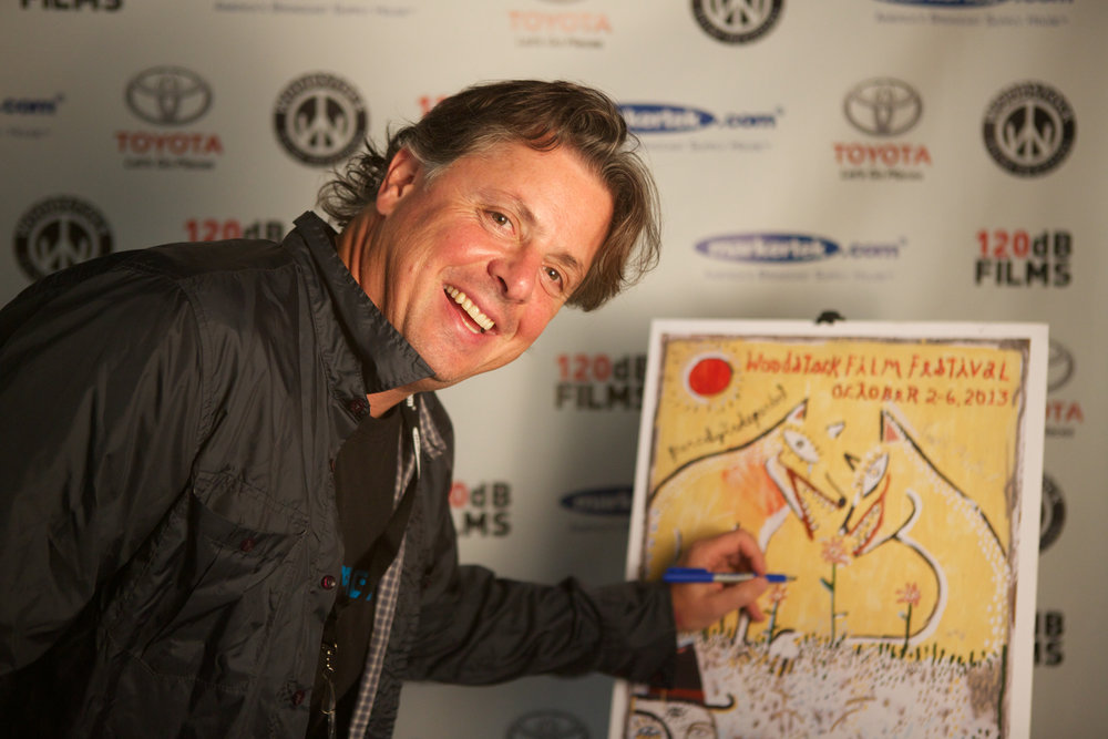 Director  Alex Smith  signs in at the 2013 Woodstock Film Festival.