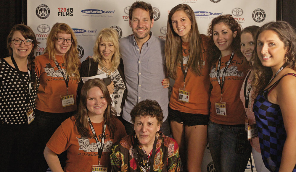 Paul Rudd posing for a photo with interns and staffers