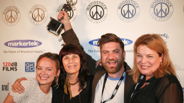 Beauty Mark wins the Ultra Indie Award at the 2017 Woodstock Film Festival. Auden Thornton, Meira Blaustein, Harris Doran, and Catherine Curtin celebrate.