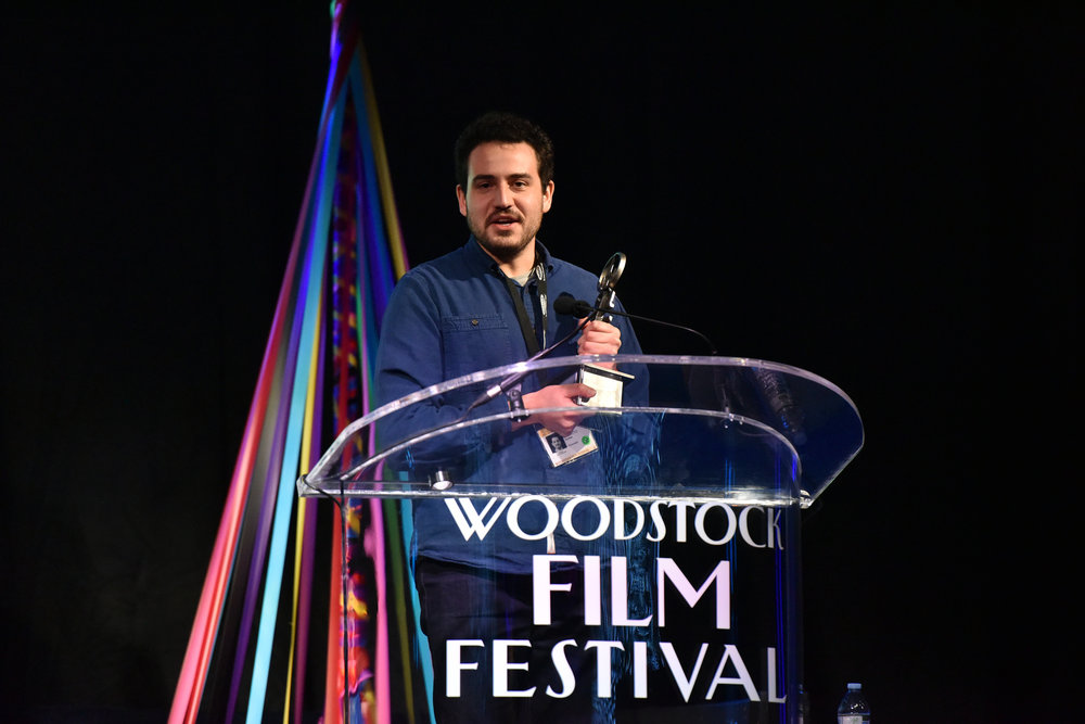 Alex Moratto winning the Ultra Indie Award at the Woodstock Film Festival.
