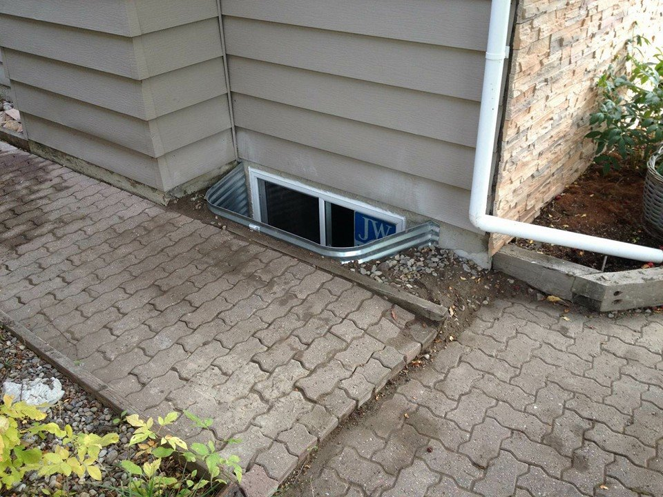 Tight space for a new egress window, and window well? We think not.