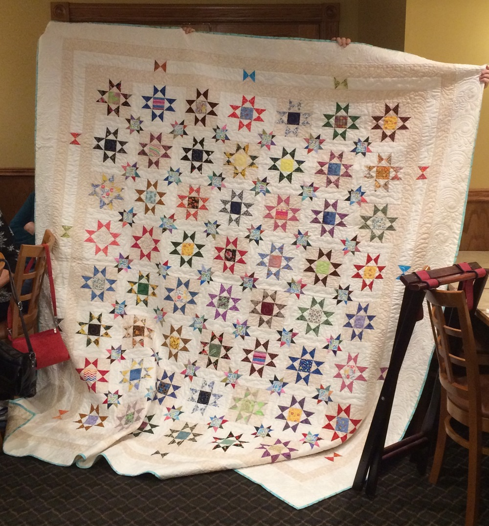 """Star by Star""                                      Designed by BarbaraSue Waldrip, pieced by IVQG members, and quilted by Carol Betts.                    This beautiful quilt was donated to the Illinois Valley Breast Cancer Connection Pink Ribbon Club in 2015."