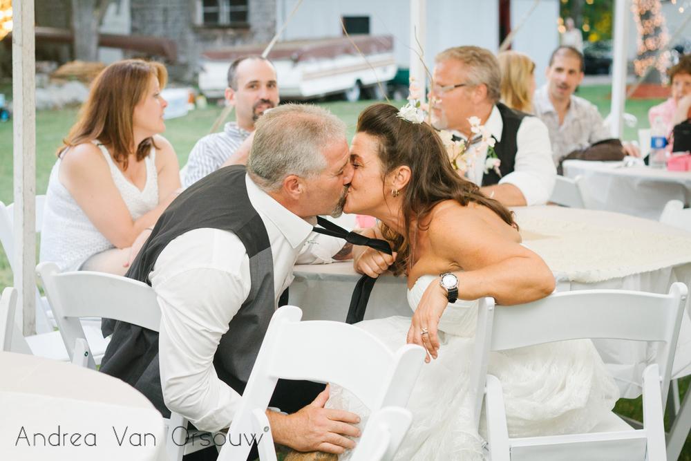 bride_tie_grab_kiss.jpg