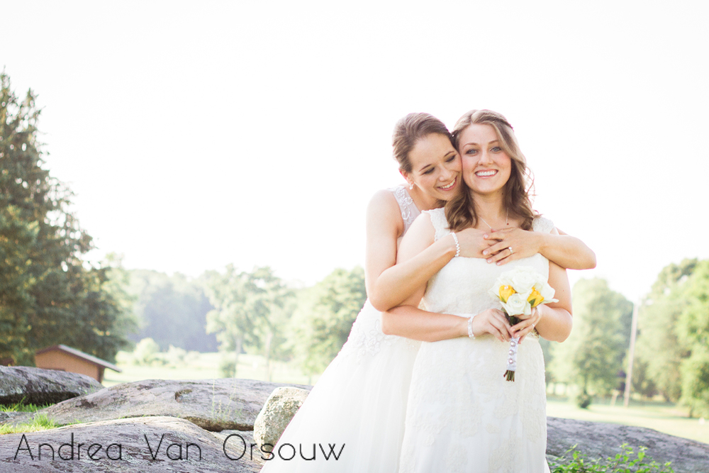 two_brides_bouquet_hug.jpg