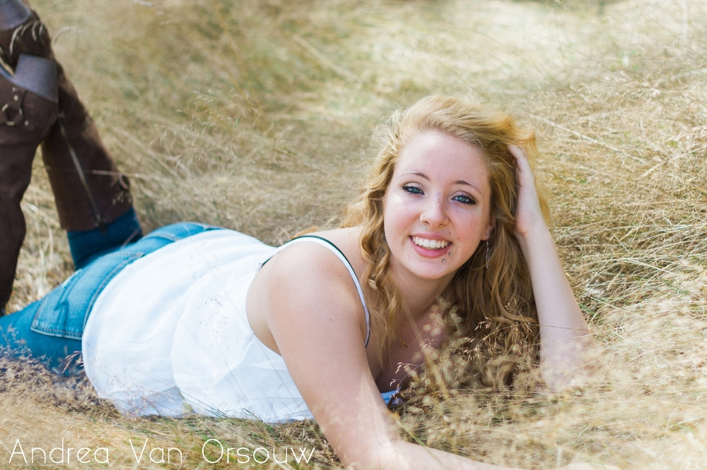 senior_girl_laying_on_hay.jpg