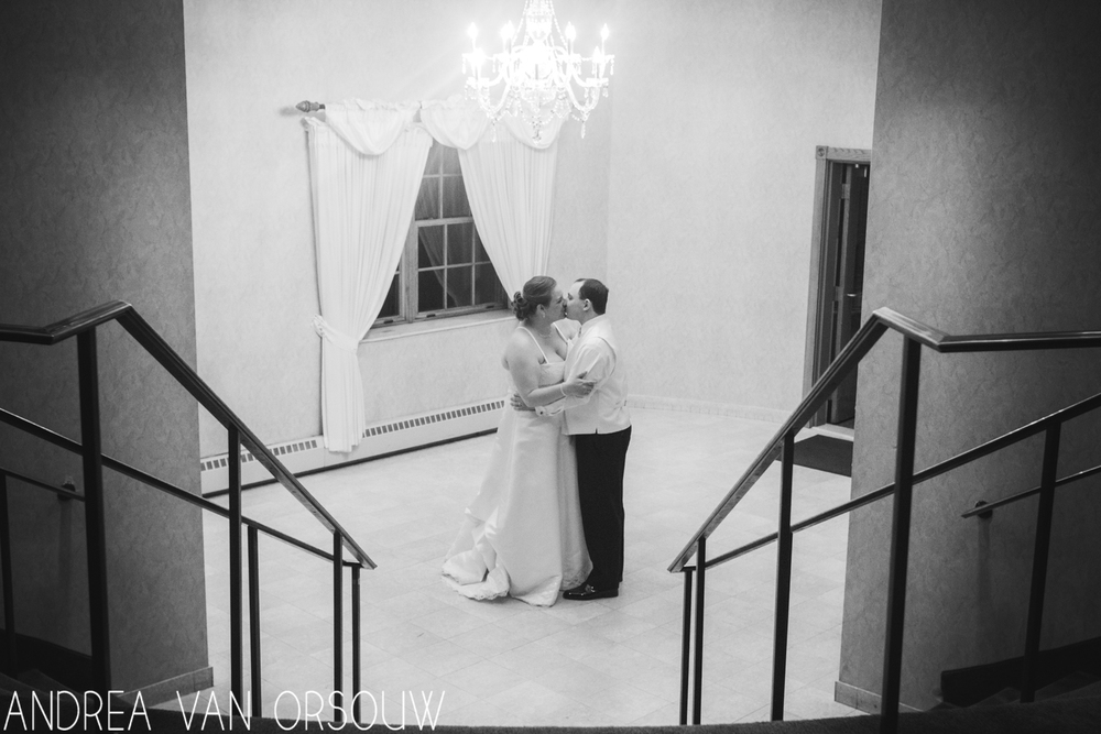 raling_chandelier_indoors_wedding_couple_connecticut_photographer_black_and_white.jpg