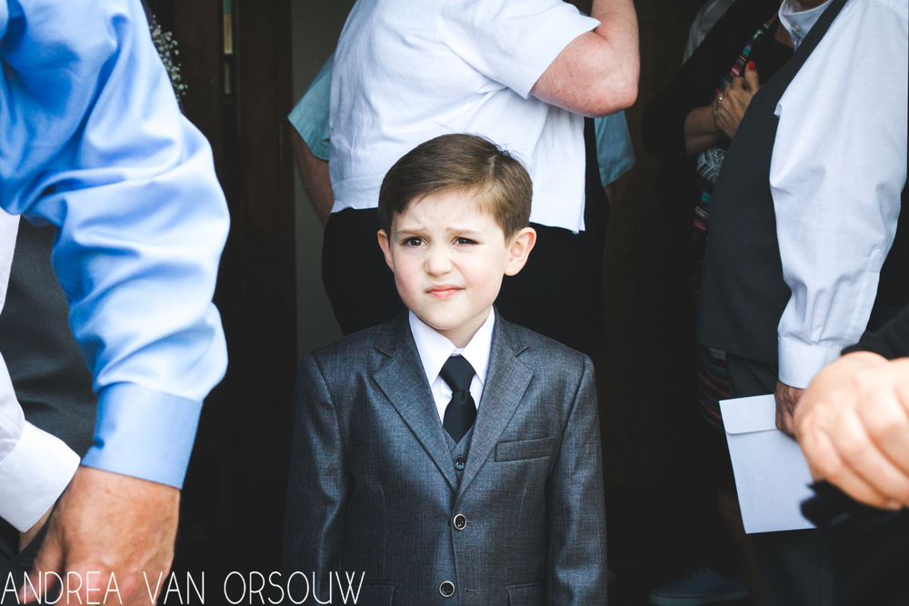 bored_ringbearer_boy_at_church_wedding_suit_ct_photographer.jpg