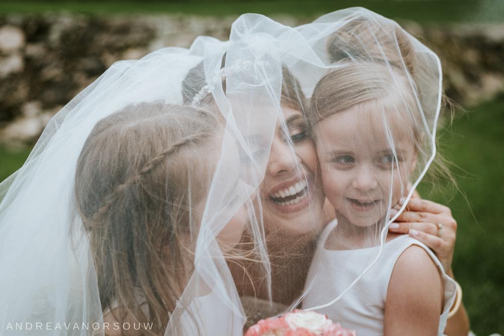 bride_flower_girls_veil_wedding_day_white_cute_new_england_photographer.jpg