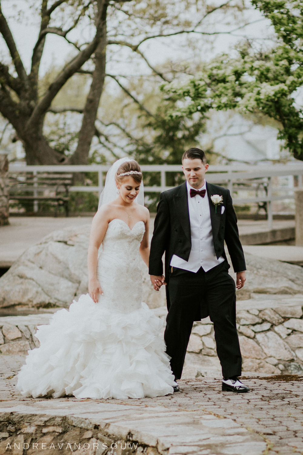 bride_and_groom_walking_portrait_session_wedding_day_connecticut_coast_guard_academy_new_england_rhode_island_photographer.jpg