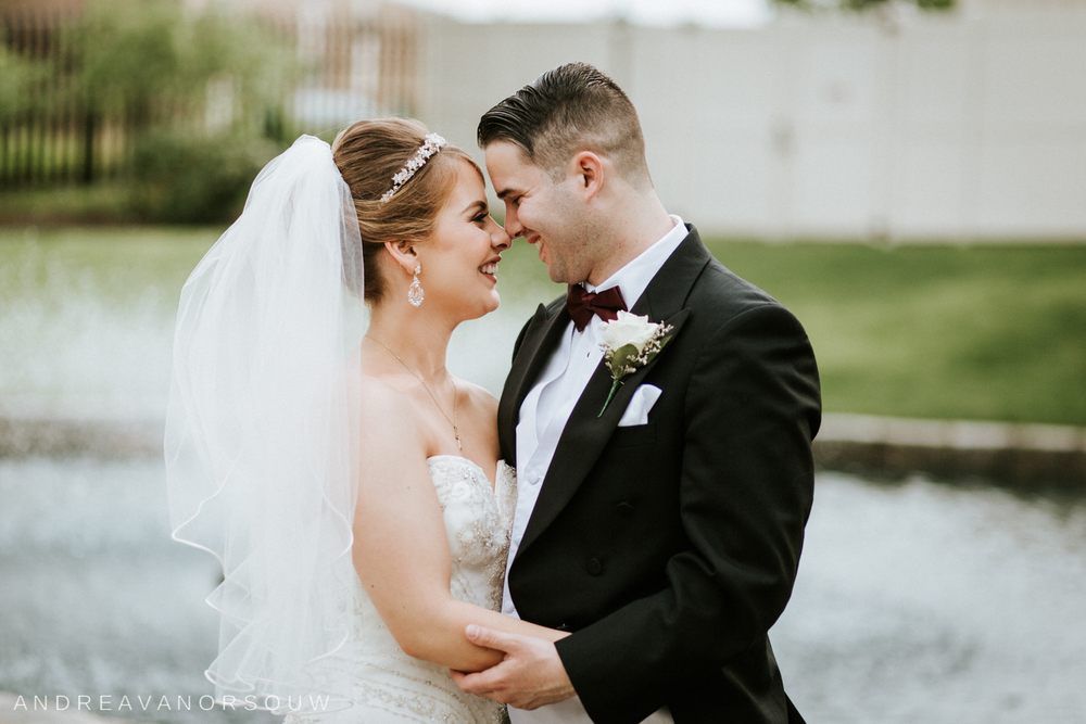 bride_groom_couple_close_pose_wedding_day_connecticut_photographer_coast_guard_academy.jpg