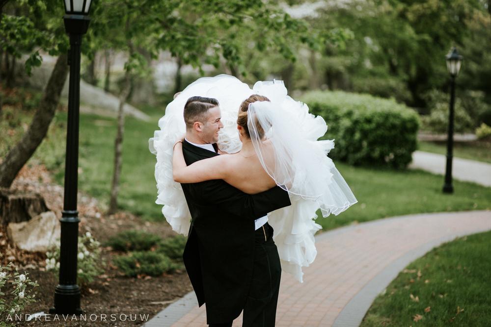 groom_carry_bride_big_dress_fun_happy_adventurous_connecticut_Wedding_photography.jpg