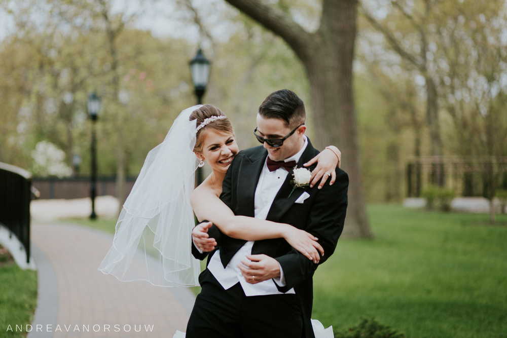 funny_laughing_bride_groom_natural_sunglasses_surpise_connecticut_wedding_photographer.jpg