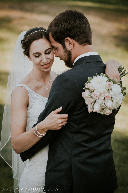 wedding_bride_grrom_bouquet_valley_country_club_dark_summer_wedding_couple_pose_rhode_island_connecticut_new_england.jpg