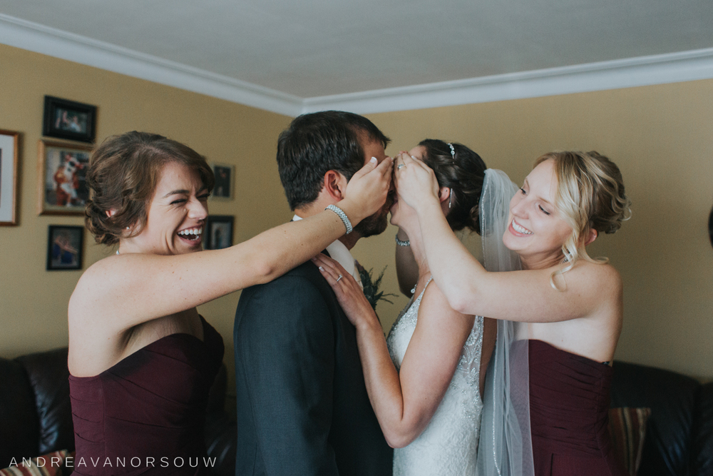 bride_and_groom_dont_see_eachother_bridesmaids_rhode_island_connecticut_photographer_new_england.jpg