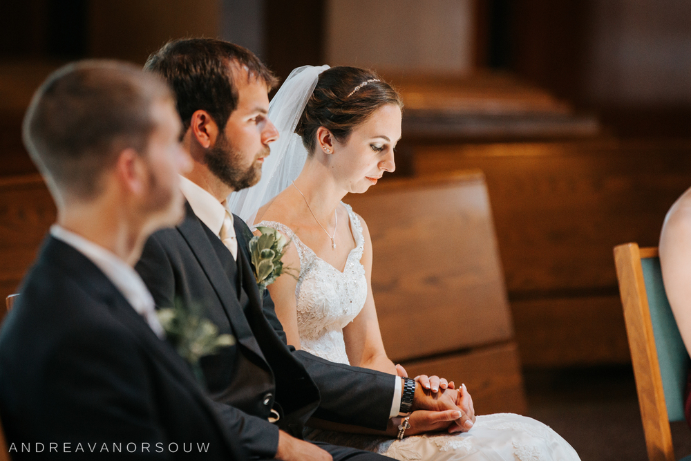 bride_groom_at_alter_rhode_island_connecticut_new_england_weddings.jpg