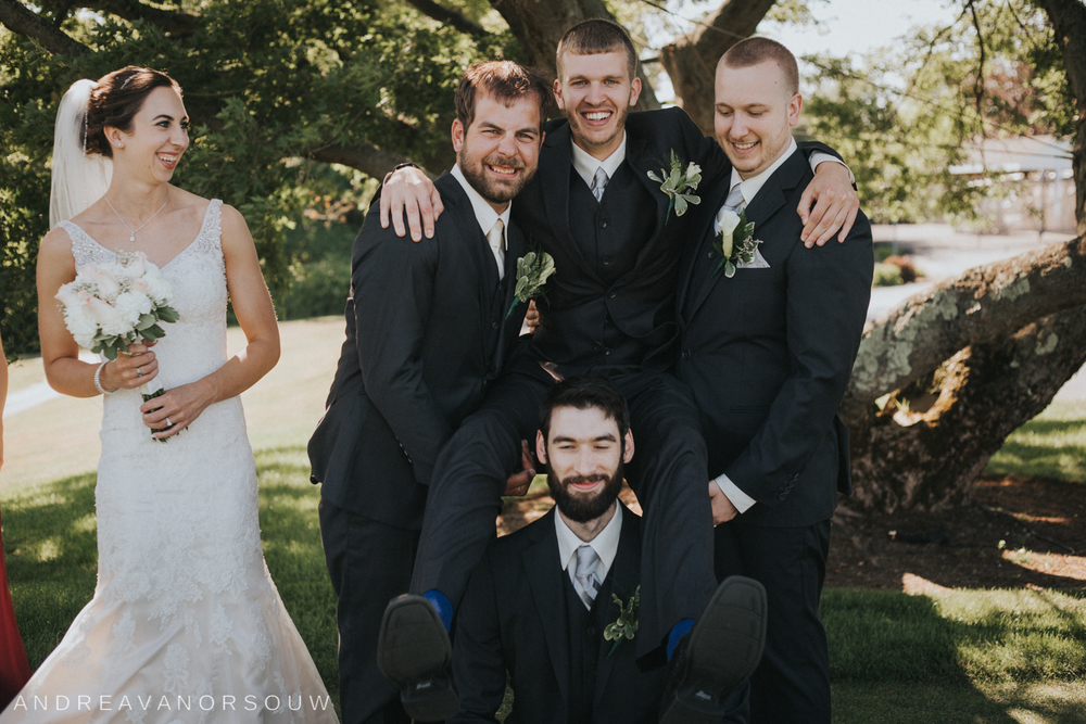 groomsmen_silly_funny_pose_wedding_bride_laughing_rhode_island_connecticut_new_england_weddings.jpg