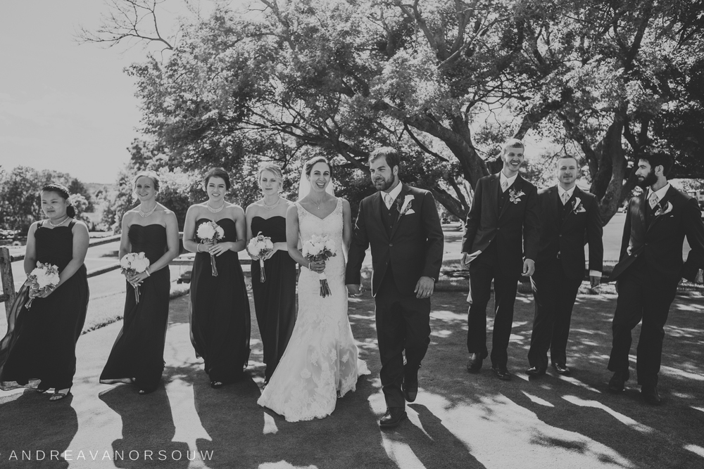 bridal_party_black_and_white_walking_fun_rhode_island_connecticut_new_england_weddings.jpg