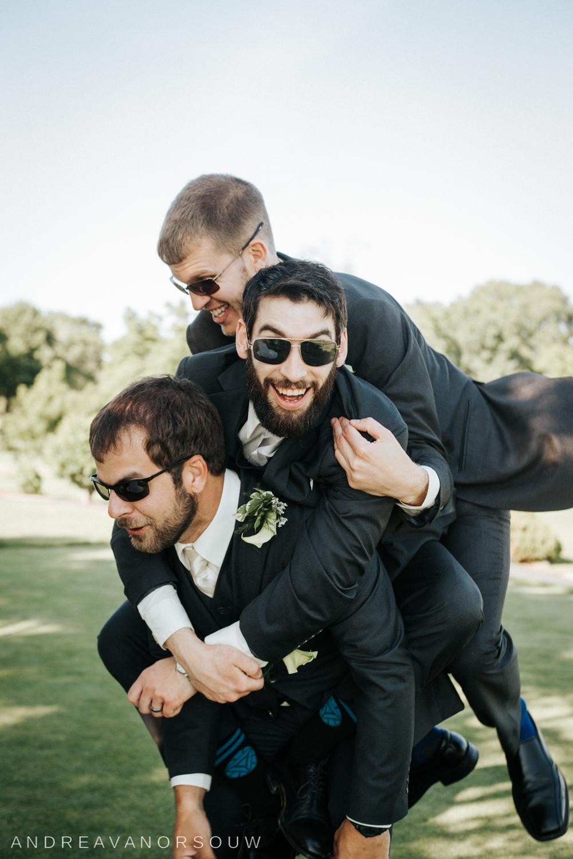 fun_groomsmen_groom_piggy_back_funny_silly_poserhode_island_connecticut_new_england_weddings.jpg