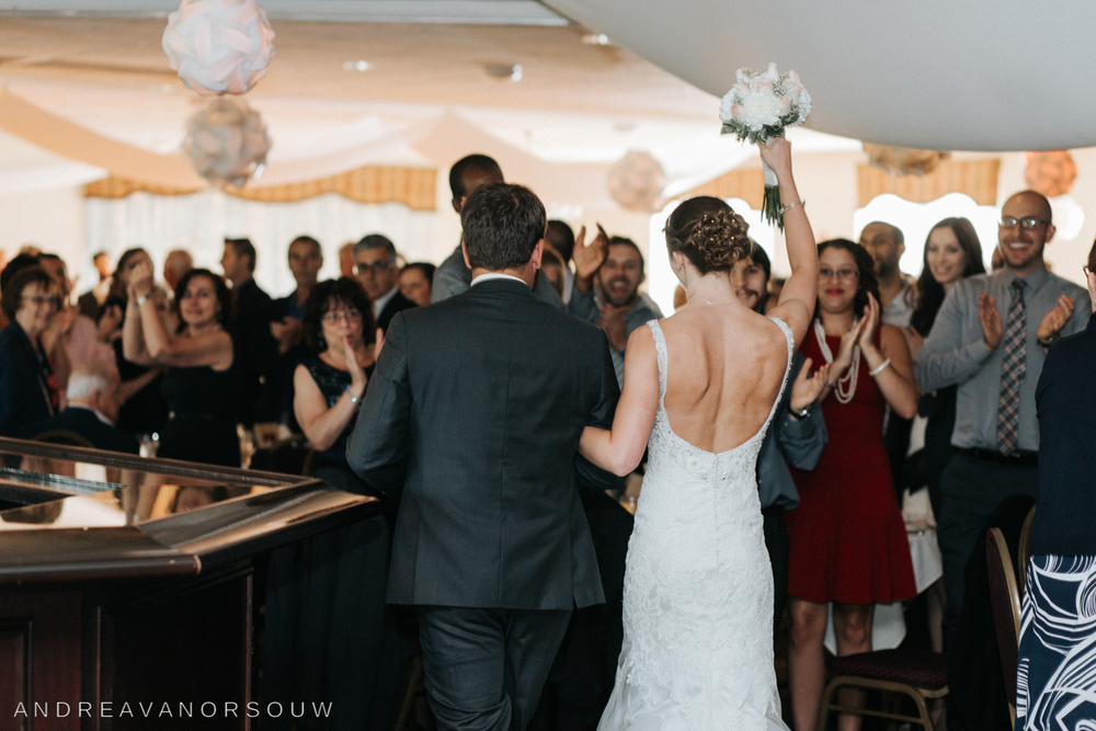grand_entance_groom_bride_guests_bouquet_valley_country_club_wedding.jpg