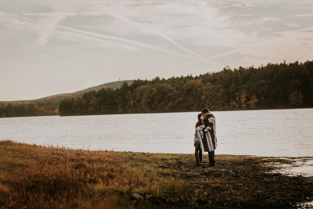 fall_foliage_autumn_blanket_mexican_yoga_blanket_river_holyoke_reservoir_adventure_outdoors_trees_dress_outdoors_connecticut_rhode_island_massachusetts_new_england_wedding_photography_photographer_natural_laid_back_fun_light_engagement_session.jpg